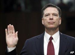 FILE - Former FBI Director James Comey is sworn in during a Senate Intelligence Committee hearing on Capitol Hill in Washington, June 8, 2017.