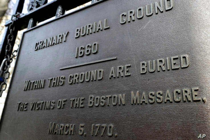 A plaque is posted at the entrance to the Granary Burial Ground in Boston, March 3, 2020.