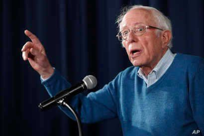 Democratic presidential candidate Sen. Bernie Sanders, I-Vt., gestures while speaking during a news conference at his New…