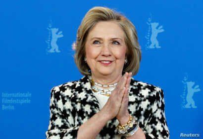 Hillary Clinton gestures as she attends a photo call to promote the movie