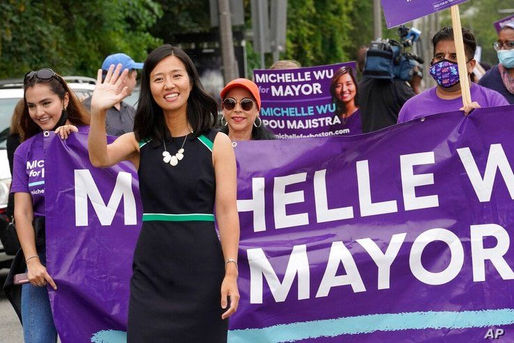 FILE— In this July 18, 2021 file photograph, Boston mayoral candidate Michelle Wu waves while walking in the Roxbury Unity…