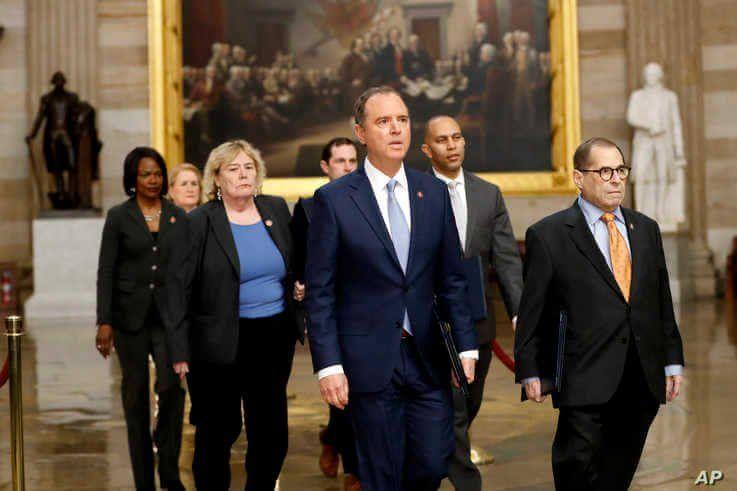 Impeachment managers walk through rotunda on their way to Senate on Capitol Hill, Jan. 16, 2020.