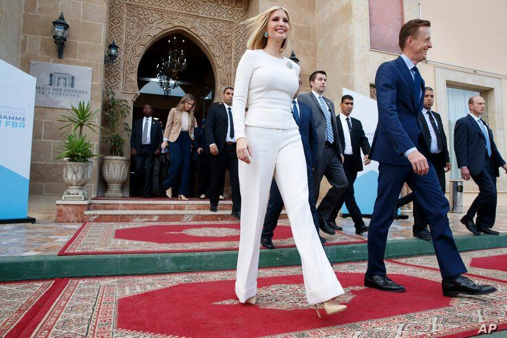 Ivanka Trump, the daughter and senior adviser to President Donald Trump, left, leaves an event at the