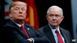 FILE - President Donald Trump sits with Attorney General Jeff Sessions during an FBI National Academy graduation ceremony in Quantico, Virginia, Dec. 15, 2017.