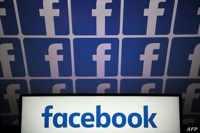 FILE - A photo taken July 4, 2019, in Nantes, France, shows logos of the U.S.-based social media platform Facebook.