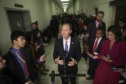 House Intelligence Committee Chairman Adam Schiff talks to the media after acting Director of National Intelligence Joseph Maguire testified before the committee on Capitol Hill in Washington, Sept. 26, 2019.