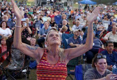 Sandra Wilhelm from Vanceboro, N.C. worships before evangelist The Rev. Franklin Graham speaks at his Decision America event at…