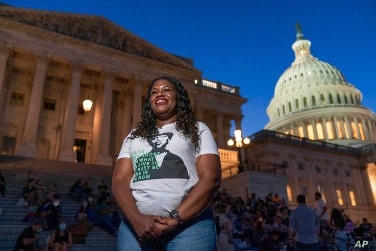 Rep. Cori Bush, D-Mo., speaks with reporters as she camps outside the U.S. Capitol, in Washington, Monday, Aug. 2, 2021, as…