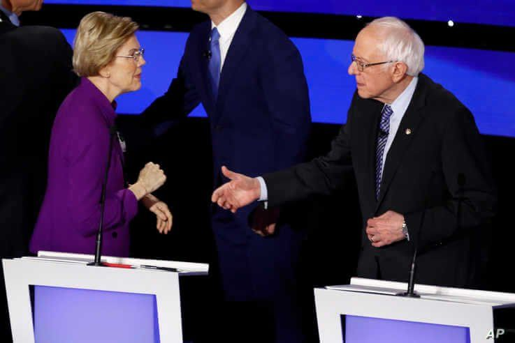 Democratic presidential candidates Sen. Elizabeth Warren and Sen. Bernie Sanders on Jan. 14, 2020, after a Democratic presidential primary debate in Des Moines, Iowa.