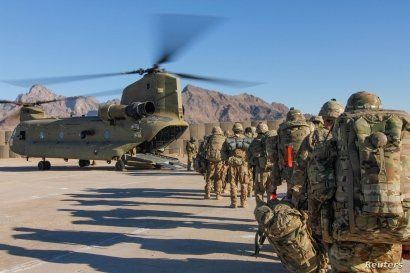 U.S. soldiers attached to the 101st Resolute Support Sustainment Brigade, Iowa National Guard and 10th Mountain, 2-14 Infantry Battalion, load onto a Chinook helicopter to head out on a mission in Afghanistan, Jan. 15, 2019.