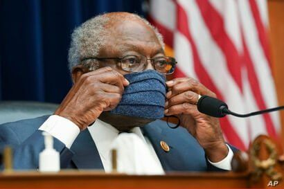 Committee Chairman Rep. James Clyburn, D-S.C.,  adjusts his protective face mask as he chairs  a House Select Subcommittee on…