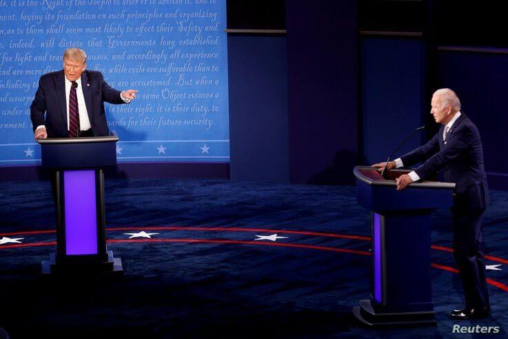FILE PHOTO: U.S. President Donald Trump and Democratic presidential nominee Joe Biden participate in their first 2020…