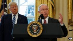 FILE - President Donald Trump listens as Attorney FILE - General Jeff Sessions speaks in the Oval Office of the White House in Washington, Feb. 9, 2017, after Vice President Mike Pence administered the oath of office to Sessions.