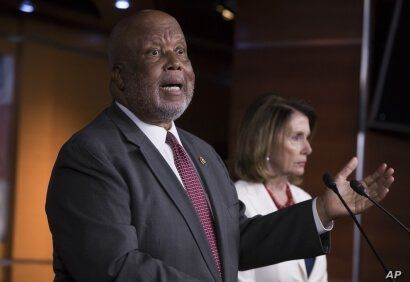 Rep. Bennie Thompson, D-Miss., the ranking member of the House Homeland Security Committee, joins House Minority Leader Nancy Pelosi, D-Calif., right, at a news conference on Russian meddling in Washington, June 29, 2017.
