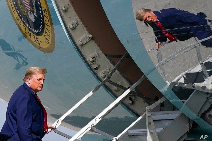 President Donald Trump boards Air Force One at Palm Beach International Airport, Thursday, Dec. 31, 2020, in West Palm Beach,…