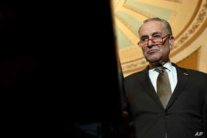 Senate Minority Leader Sen. Chuck Schumer of N.Y., listens during a news conference on Capitol Hill in Washington, Tuesday, Feb…