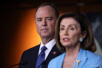U.S. House Speaker Nancy Pelosi (D-CA) addresses reporters as House Intelligence Committee Chairman Adam Schiff (D-CA) looks on…