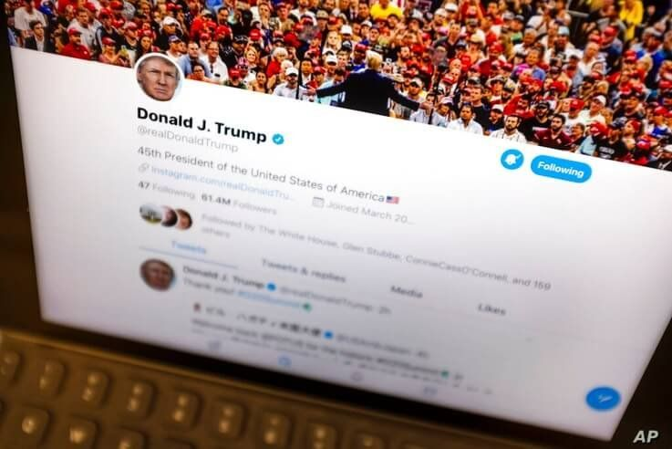 FILE - This June 27, 2019, file photo President Donald Trump's Twitter feed is photographed on an Apple iPad in New York. Amid…