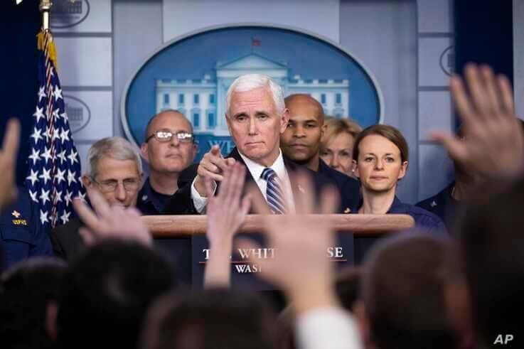 Vice President Mike Pence points to a question as he speaks during a briefing about the coronavirus in the James Brady Press Briefing Room of the White House, Sunday, March 15, 2020, in Washington.