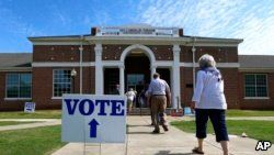 Voters arrive to cast their ballots during the Alabama Primary election at Huntingdon College in Montgomery, Alabama, June 5, 2018.