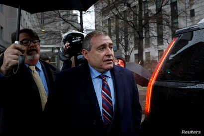 FILE - Lev Parnas, associate of President Donald Trump's personal lawyer Rudy Giuliani, exits after a bail hearing at the Manhattan Federal Court in New York, Dec. 17, 2019.