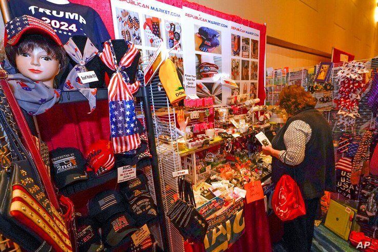 Conservative shirts, hats, ties and other items are displayed for sale at the merchandise show at the Conservative Political…
