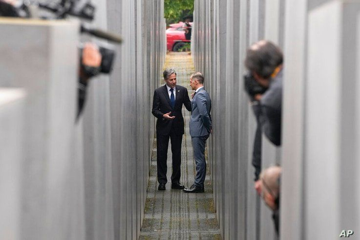 Media cover US Secretary of State Antony Blinken, left, and German Foreign Minister Heiko Maas as they talk together inside the…