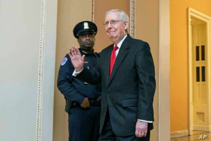 Senate Majority Leader Mitch McConnell, R-Ky., waves as the impeachment trial of President Donald Trump concludes on Capitol…