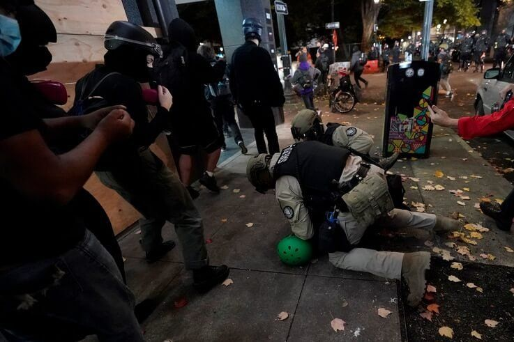 Oregon State Police arrest a protester in Portland, Ore., Wednesday, Nov. 4, 2020, following Tuesday's election. (AP Photo…