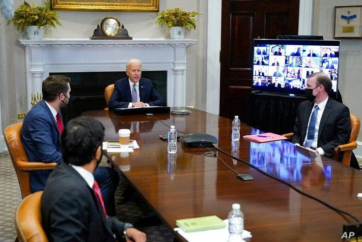 President Joe Biden participates virtually in the CEO Summit on Semiconductor and Supply Chain Resilience in the Roosevelt Room…