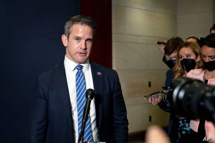 FILE - Congressman Adam Kinzinger, a Republican from Illinois, speaks to reporters at the Capitol in Washington, May 12, 2021.