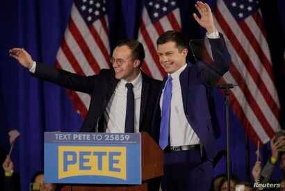 Democratic U.S. presidential candidate and former South Bend Mayor Pete Buttigieg waves to the crowd with his husband Chasten…
