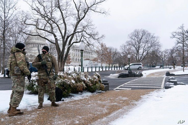National Guard soldiers stand their post on the House side of the U.S. Capitol on  Feb. 1, 2021, in Washington. (AP Photo…