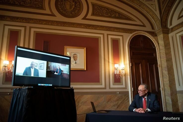 Senate Minority Leader Chuck Schumer (D-NY) speaks virtually with retired U.S. General Lloyd Austin, nominated by President…