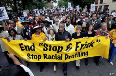 File-This photo from June 17, 2012, shows Rev. Al Sharpton, with demonstrators during a silent march to end to end the