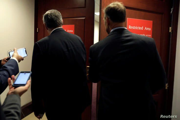 Members of Congress head to a resticted area for a closed-door deposition held as part of House Democrats' impeachment inquiry into President Donald Trump on Capitol Hill in Washington, Oct. 23, 2019.