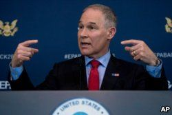 FILE - Environmental Protection Agency Administrator Scott Pruitt speaks at a news conference at EPA offices in Washington, April 3, 2018.