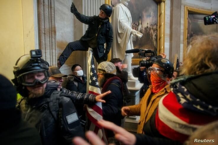 Pro-Trump protesters storm the U.S. Capitol to contest the certification of the 2020 U.S. presidential election results by the…