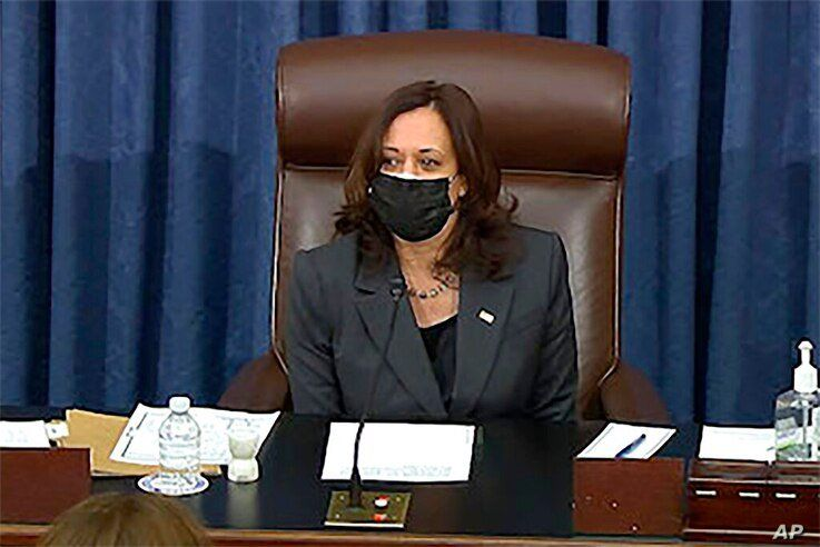 In this image from Senate TV, Vice President Kamala Harris sits in the chair on the Senate floor to cast the tie-breaking vote,…