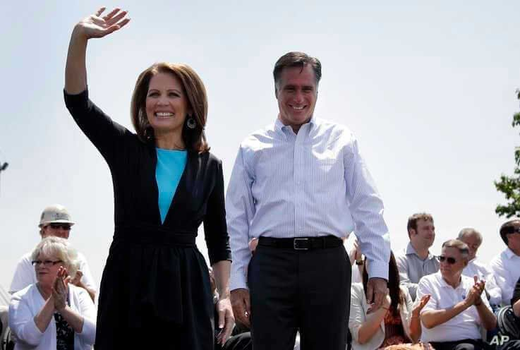 FILE - In this May 3, 2012, photo, Rep. Michele Bachmann of Minnesota joins Republican presidential candidate Mitt Romney at a campaign stop in Portsmouth, Virginia.