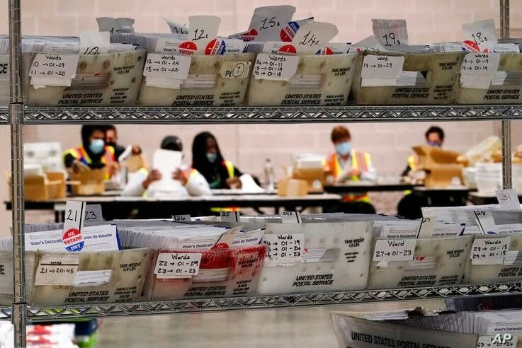 Workers with the Philadelphia City Commissioners office sort election materials for the 2020 General Election in the United…