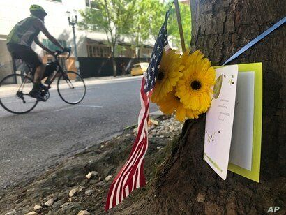 A small memorial to Portland, Oregon fatal shooting victim Aaron J. Danielson, 39, of Portland is shown on Monday, Aug. 31,…