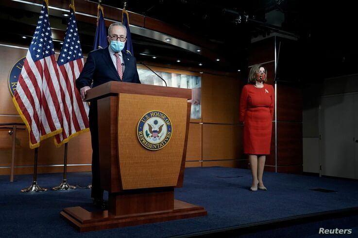 Senate Minority Leader Charles Schumer (D-NY) speaks to reporters on an agreement of a COVID-19 aid package with Speaker of the House Nancy Pelosi (D-CA) on Capitol Hill Washington, D.C., Dec. 20, 2020.