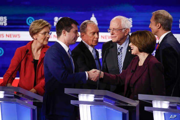 From left, Democratic presidential candidates, Sen. Elizabeth Warren, D-Mass., former South Bend Mayor Pete Buttigieg, former…