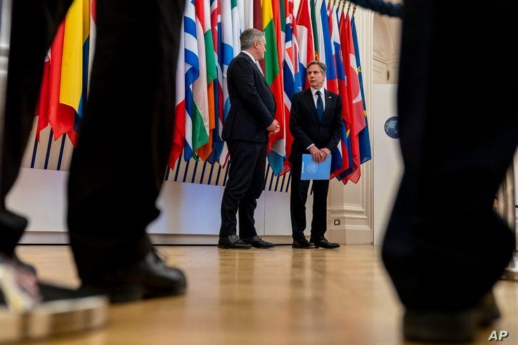 US Secretary of State Antony Blinken, right, accompanied by Secretary-General of the Organization for Economic Cooperation and…