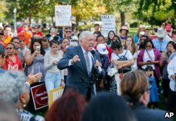 FILE - House Minority Whip Steny Hoyer, D-Md., center, speaks to immigrant rights supporters at the U.S. Capitol in Washington, Sept. 26, 2017.