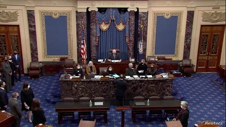 U.S. House lead impeachment manager Jamie Raskin (D-MD) hands over the House article of impeachment against former President…