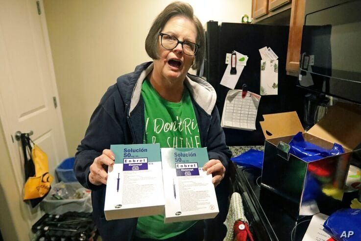 In this Jan. 31, 2020, photo, Ann Lovell holds her prescriptions at her home in South Jordan, Utah, after returning to Salt…