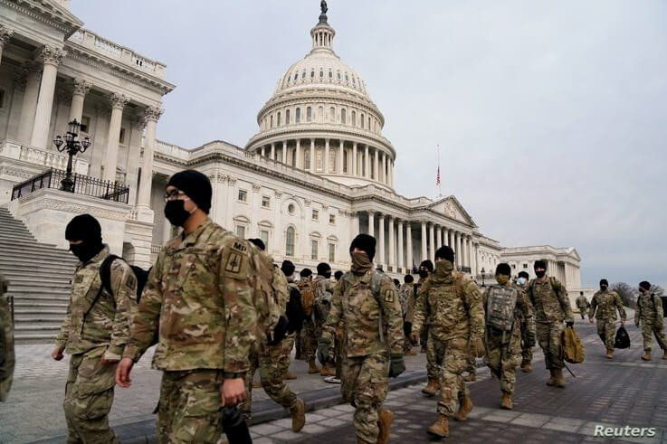 Members of the National Guard arrive to the U.S. Capitol days after supporters of U.S. President Donald Trump stormed the…