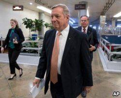 Sen. Dick Durbin, D-Ill., followed by Sen. Bob Menendez, D-N.J., walks to the Senate as Congress moves closer to the funding deadline to avoid a government shutdown, at the Capitol in Washington, Jan. 18, 2018.